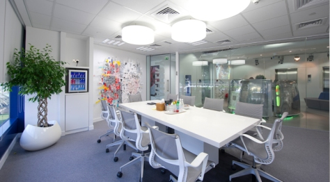 "The ""Gallery"" meeting room features original artwork designed by RedBull fans, made from RedBull cans."