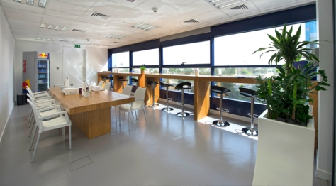 The pantry at Red Bull Dubai is a place where people get together informally and hold whole-company meetings.