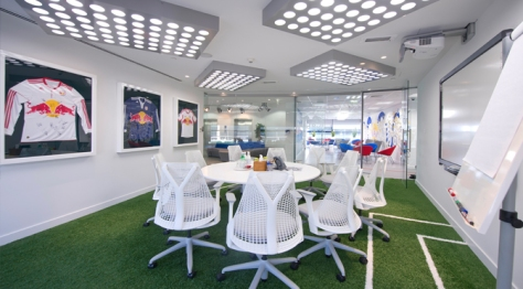 The Field meeting room, which is themed to represent sport with astroturf flooring, pitch  markings and replica stadium lighting.